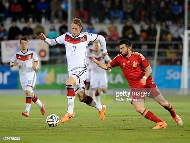 Andre Hofmann of Germany battles with Jordi Amat of Spain during an U21 international friendly match between Spain and Germany on March 4 2014 at the...
