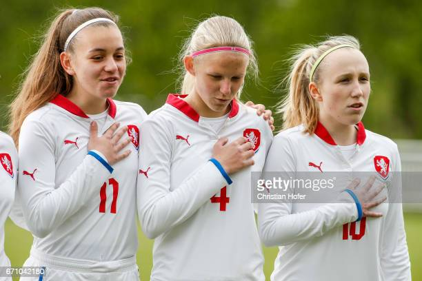 Andre Hola Lucie Jelinkova and Hana Pavlasova of Czech Republic line up during the national anthem prior to the Under 15 girls international friendly...