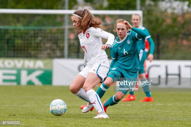 Andre Hola of Czech Republic challenges Lisanne Grawe of Germany for the ball during the Under 15 girls international friendly match between Czech...