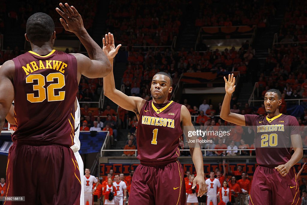 Andre Hollins #1 and Trevor Mbakwe #32 of the Minnesota Golden Gophers celebrate against the Illinois Fighting Illini during the game at Assembly Hall on January 9, 2013 in Champaign, Illinois. Minnesota won 84-67.
