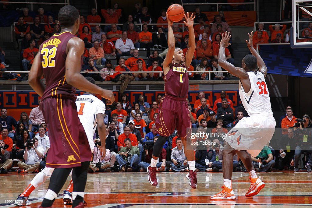 Andre Hollins #1 of the Minnesota Golden Gophers passes the ball against pressure from Nnanna Egwu #32 of the Illinois Fighting Illini during the game at Assembly Hall on January 9, 2013 in Champaign, Illinois. Minnesota won 84-67.