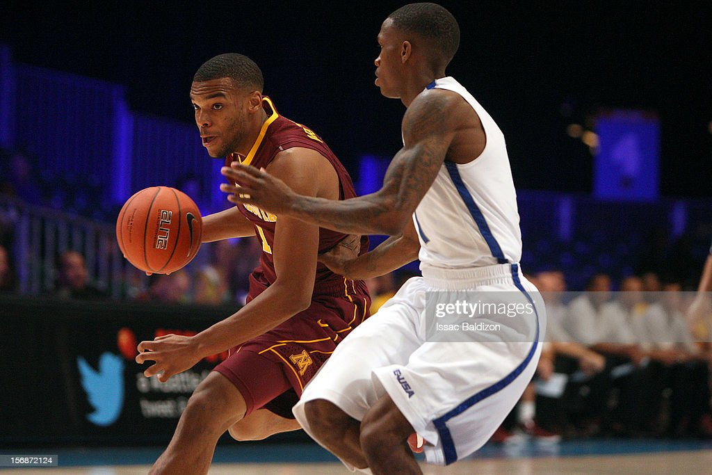 Andre Hollins #1 of the Minnesota Gophers dribbles against Joe Jackson #1 of the Memphis Tigers during the Battle 4 Atlantis tournament at Atlantis Resort November 23, 2012 in Nassau, Paradise Island, Bahamas.