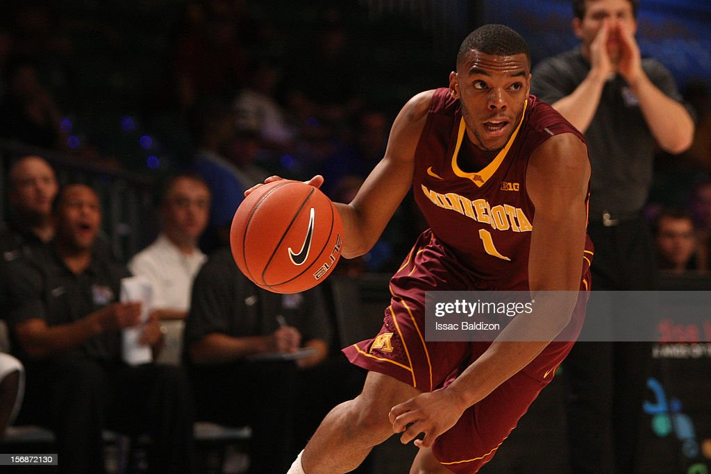 Andre Hollins #1 of the Minnesota Gophers dribbles against the Memphis Tigers during the Battle 4 Atlantis tournament at Atlantis Resort November 23, 2012 in Nassau, Paradise Island, Bahamas.