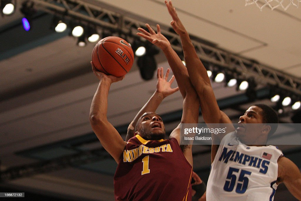 Andre Hollins #1 of the Minnesota Gophers shoots over Geron Johnson #55 of the Memphis Tigers during the Battle 4 Atlantis tournament at Atlantis Resort November 23, 2012 in Nassau, Paradise Island, Bahamas.