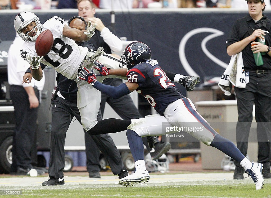 <a gi-track='captionPersonalityLinkClicked' href=/galleries/search?phrase=Andre+Holmes&family=editorial&specificpeople=7536989 ng-click='$event.stopPropagation()'>Andre Holmes</a> #18 of the Oakland Raiders makes a catch as he beats Brandon Harris #26 of the Houston Texans on the play in the thrid quarter at Reliant Stadium on November 17, 2013 in Houston, Texas. The play was reviewed and ruled incomplete.