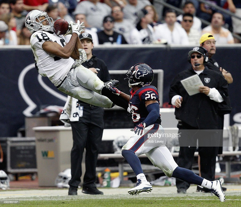 <a gi-track='captionPersonalityLinkClicked' href=/galleries/search?phrase=Andre+Holmes&family=editorial&specificpeople=7536989 ng-click='$event.stopPropagation()'>Andre Holmes</a> #18 of the Oakland Raiders makes a catch as he beats <a gi-track='captionPersonalityLinkClicked' href=/galleries/search?phrase=Brandon+Harris+-+American+Football+Cornerback&family=editorial&specificpeople=11399596 ng-click='$event.stopPropagation()'>Brandon Harris</a> #26 of the Houston Texans on the play in the third quarter at Reliant Stadium on November 17, 2013 in Houston, Texas. The play was reviewed and ruled incomplete.