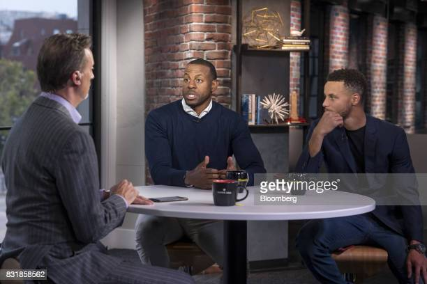 Andre Iguodala a professional basketball player with the National Basketball Association's Golden State Warriors center speaks while Stephen Curry a...
