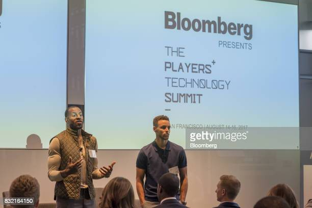 Andre Iguodala a professional basketball player with the National Basketball Association's Golden State Warriors left speaks while Stephen Curry a...