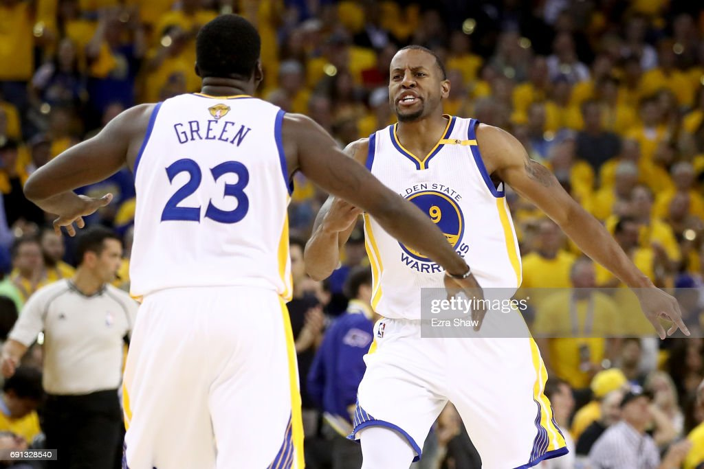 Andre Iguodala #9 and Draymond Green #23 of the Golden State Warriors react to a play against the Cleveland Cavaliers in Game 1 of the 2017 NBA Finals at ORACLE Arena on June 1, 2017 in Oakland, California.
