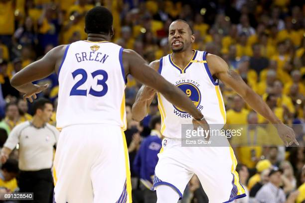 Andre Iguodala and Draymond Green of the Golden State Warriors react to a play against the Cleveland Cavaliers in Game 1 of the 2017 NBA Finals at...