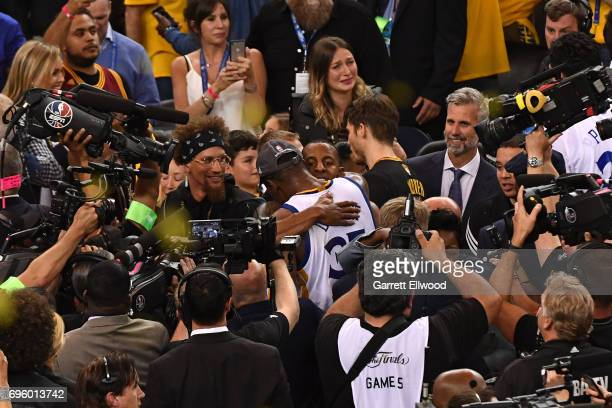 Andre Iguodala and Kevin Durant of the Golden State Warriors celebrate after winning the NBA Championship against the Cleveland Cavaliers in Game...