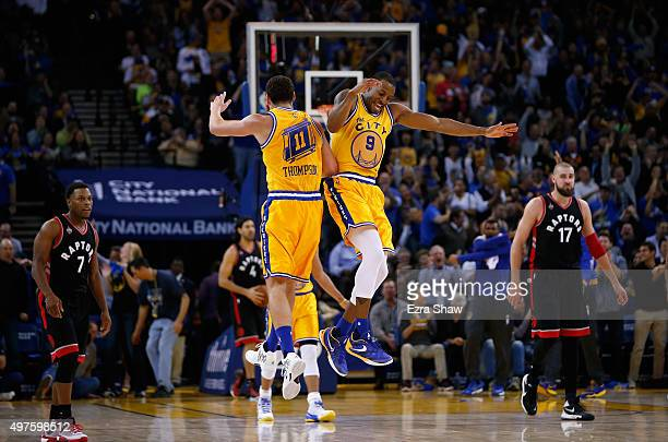 Andre Iguodala and Klay Thompson of the Golden State Warriors celebrate after Thompson threw and alleyoop dunk pass to Iguodala during their game...