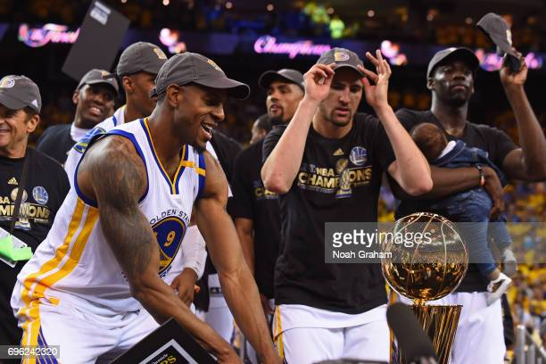 Andre Iguodala and Klay Thompson of the Golden State Warriors celebrate with the Larry O'Brien Trohpy after winning Game Five of the 2017 NBA Finals...