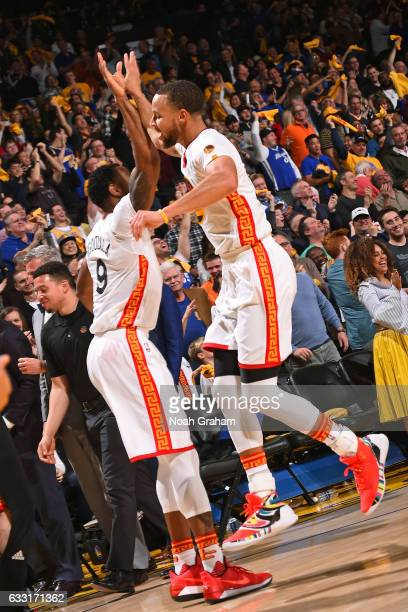 Andre Iguodala and Stephen Curry of the Golden State Warriors high five during the game against the Los Angeles Clippers on January 28 2017 at oracle...