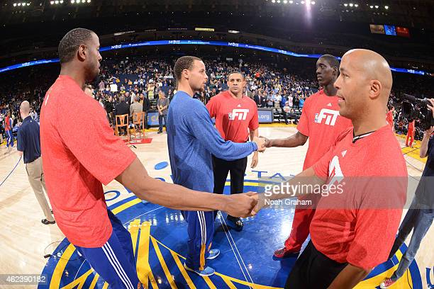 Andre Iguodala and Stephen Curry of the Golden State Warriors shakes hands with Tony Snell of the Chicago Bulls on January 21 2015 at Oracle Arena in...