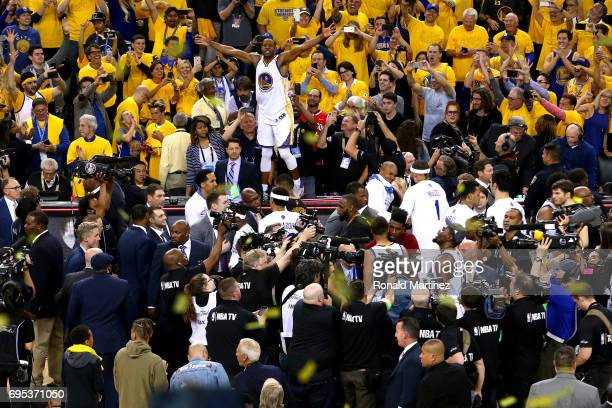 Andre Iguodala and the Golden State Warriors celebrate after beating the Cleveland Cavaliers 129120 in Game 5 to win the 2017 NBA Finals at ORACLE...