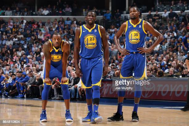 Andre Iguodala Draymond Green and Kevin Durant of the Golden State Warriors looks on during the game against the Memphis Grizzlies on October 21 2017...