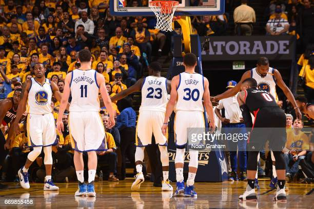 Andre Iguodala Klay Thompson Draymond Green Stephen Curry and Kevin Durant of the Golden State Warriors walk on the court during the Western...