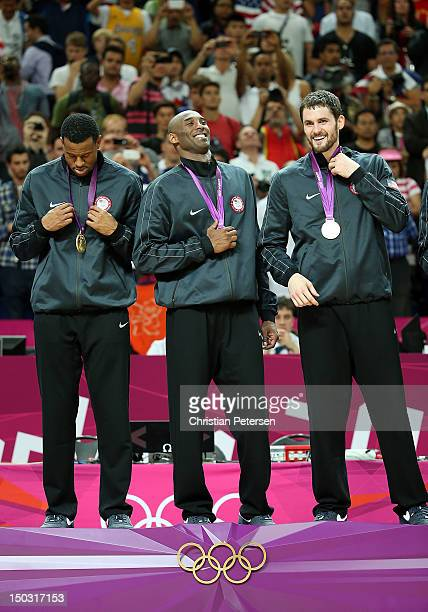 Andre Iguodala Kobe Bryant and Kevin Love of United States stand on the podium with their gold medals after defeating Spain in the Men's Basketball...