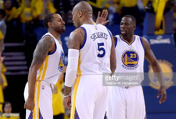 Andre Iguodala Marreese Speights and Draymond Green of the Golden State Warriors celebrates after Iguodala hit a threepoint basket against the New...