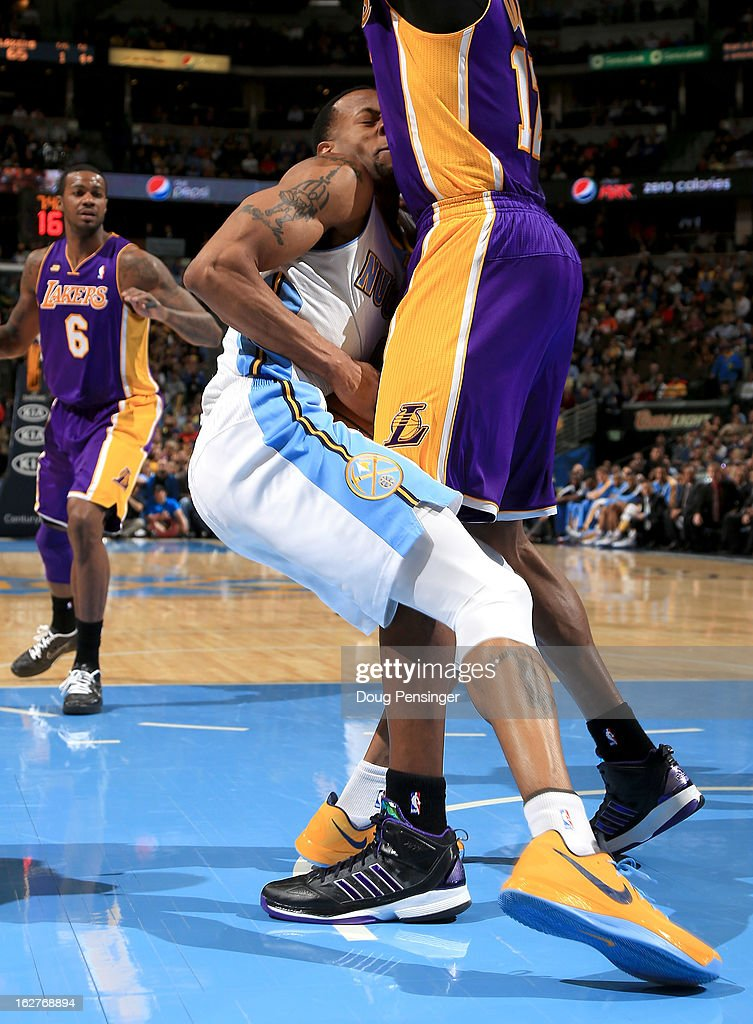 Andre Iguodala #9 of the Denver Nuggets collides with Dwight Howard #12 of the Los Angeles Lakers at the Pepsi Center on February 25, 2013 in Denver, Colorado. The Nuggets defeated the Lakers 119-108.