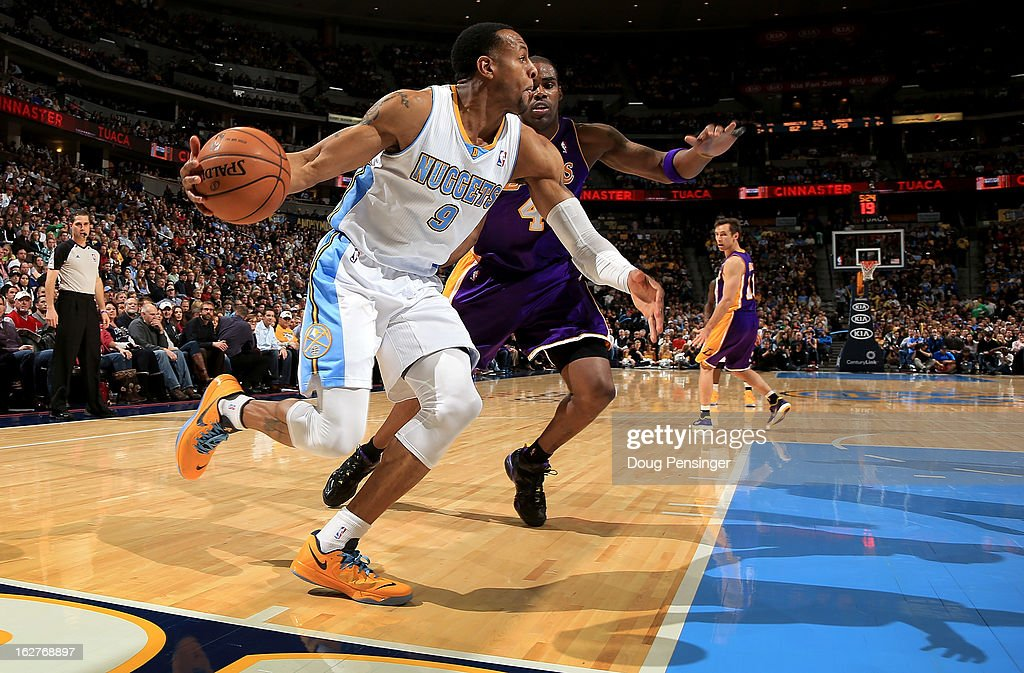 Andre Iguodala #9 of the Denver Nuggets controls the ball against Antawn Jamison #4 of the Los Angeles Lakers at the Pepsi Center on February 25, 2013 in Denver, Colorado. The Nuggets defeated the Lakers 119-108.