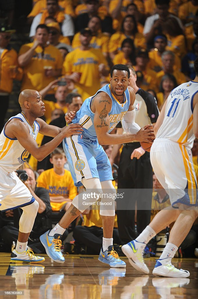 Andre Iguodala #9 of the Denver Nuggets controls the ball against Jarrett Jack #2 of the Golden State Warriors in Game Four of the Western Conference Quarterfinals during the 2013 NBA Playoffs on April 28, 2013 at the Oracle Arena in Oakland, California.