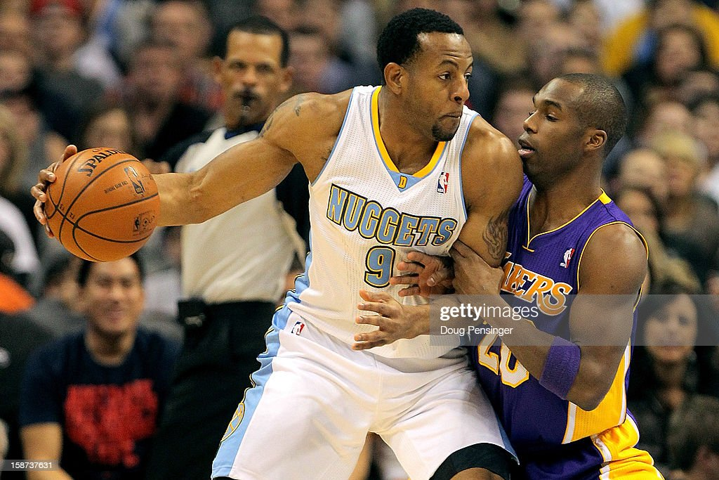 Andre Iguodala #9 of the Denver Nuggets controls the ball against Jodie Meeks #20 of the Los Angeles Lakers at Pepsi Center on December 26, 2012 in Denver, Colorado. The Nuggets defeated the Lakers 126-114.