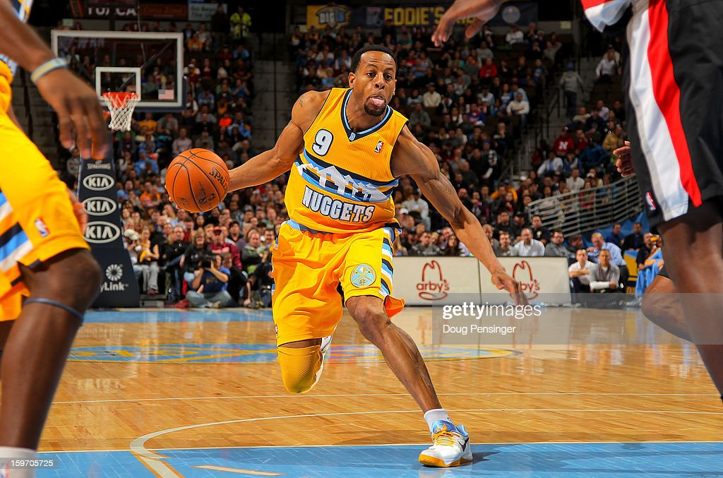 <a gi-track='captionPersonalityLinkClicked' href=/galleries/search?phrase=Andre+Iguodala&family=editorial&specificpeople=201980 ng-click='$event.stopPropagation()'>Andre Iguodala</a> #9 of the Denver Nuggets controls the ball against the Portland Trail Blazers at the Pepsi Center on January 15, 2013 in Denver, Colorado. The Nuggets defeated the Trail Blazers 115-111 in overtime.