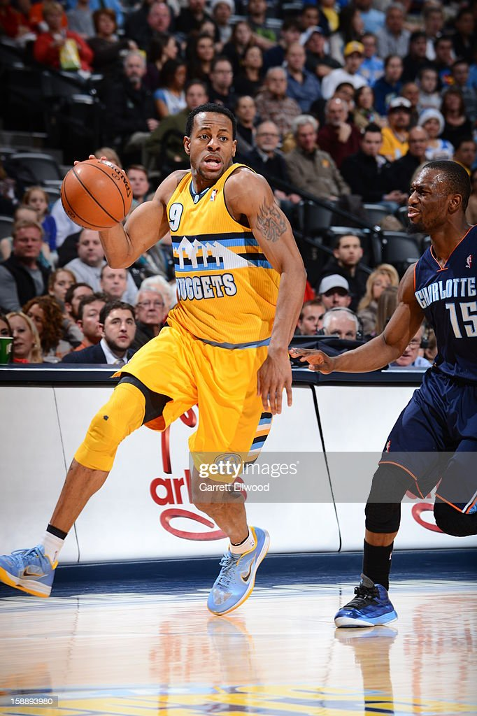 Andre Iguodala #9 of the Denver Nuggets drives against Kemba Walker #15 of the Charlotte Bobcats on December 22, 2012 at the Pepsi Center in Denver, Colorado.
