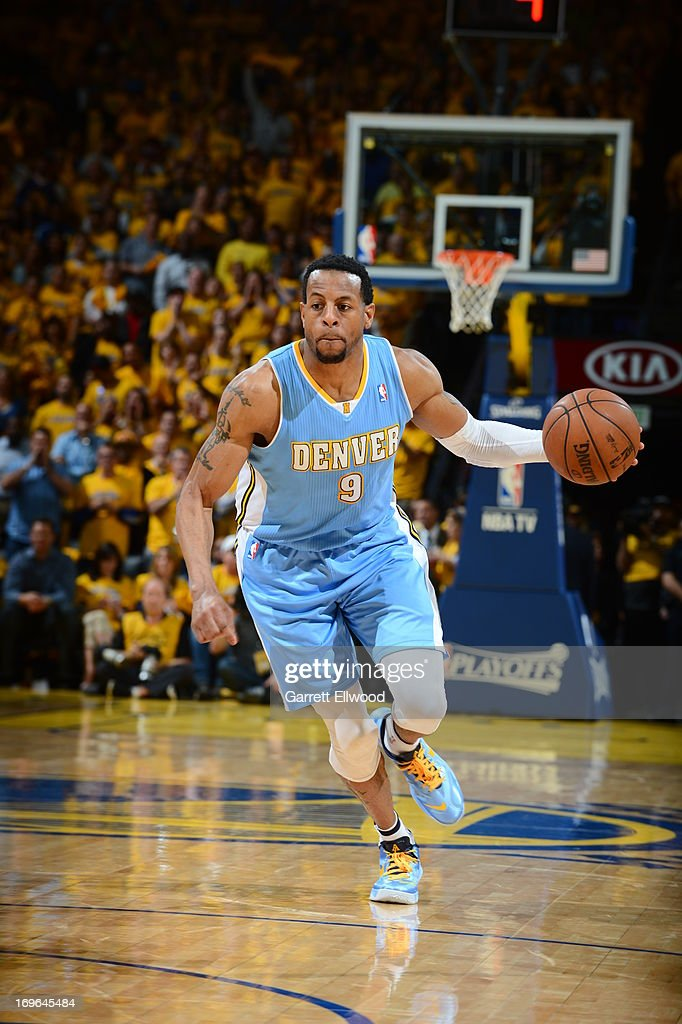 <a gi-track='captionPersonalityLinkClicked' href=/galleries/search?phrase=Andre+Iguodala&family=editorial&specificpeople=201980 ng-click='$event.stopPropagation()'>Andre Iguodala</a> #9 of the Denver Nuggets drives against the Golden State Warriors in Game Three of the Western Conference Quarterfinals during the 2013 NBA Playoffs on April 26, 2013 at the Oracle Arena in Oakland, California.