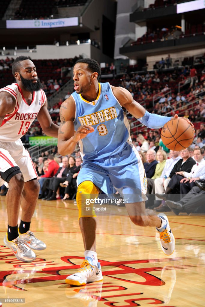 <a gi-track='captionPersonalityLinkClicked' href=/galleries/search?phrase=Andre+Iguodala&family=editorial&specificpeople=201980 ng-click='$event.stopPropagation()'>Andre Iguodala</a> #9 of the Denver Nuggets drives to the basket against the Houston Rockets on January 23, 2013 at the Toyota Center in Houston, Texas.