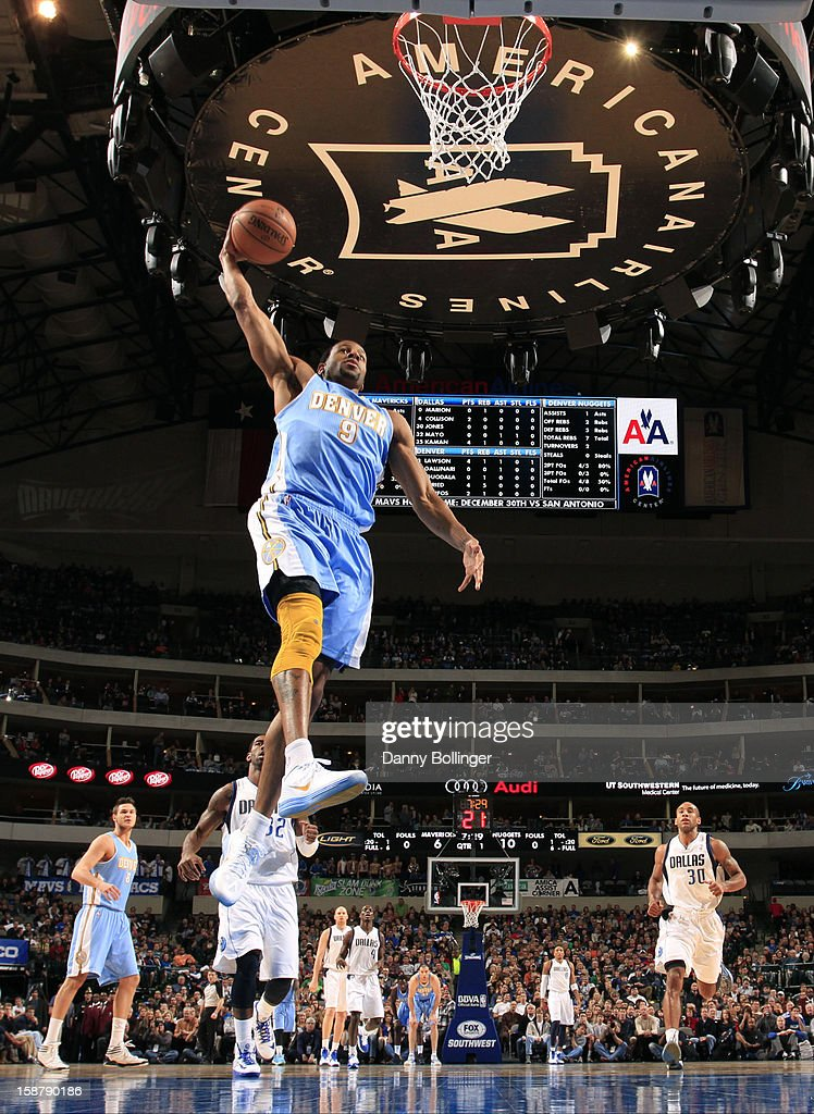 Andre Iguodala #9 of the Denver Nuggets dunks against the Dallas Mavericks on December 28, 2012 at the American Airlines Center in Dallas, Texas.