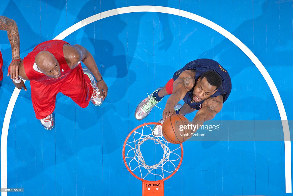 <a gi-track='captionPersonalityLinkClicked' href=/galleries/search?phrase=Andre+Iguodala&family=editorial&specificpeople=201980 ng-click='$event.stopPropagation()'>Andre Iguodala</a> #9 of the Denver Nuggets dunks ahead of <a gi-track='captionPersonalityLinkClicked' href=/galleries/search?phrase=Lamar+Odom&family=editorial&specificpeople=201519 ng-click='$event.stopPropagation()'>Lamar Odom</a> #7 of the Los Angeles Clippers during a Christmas Day game at Staples Center on December 25, 2012 in Los Angeles, California.