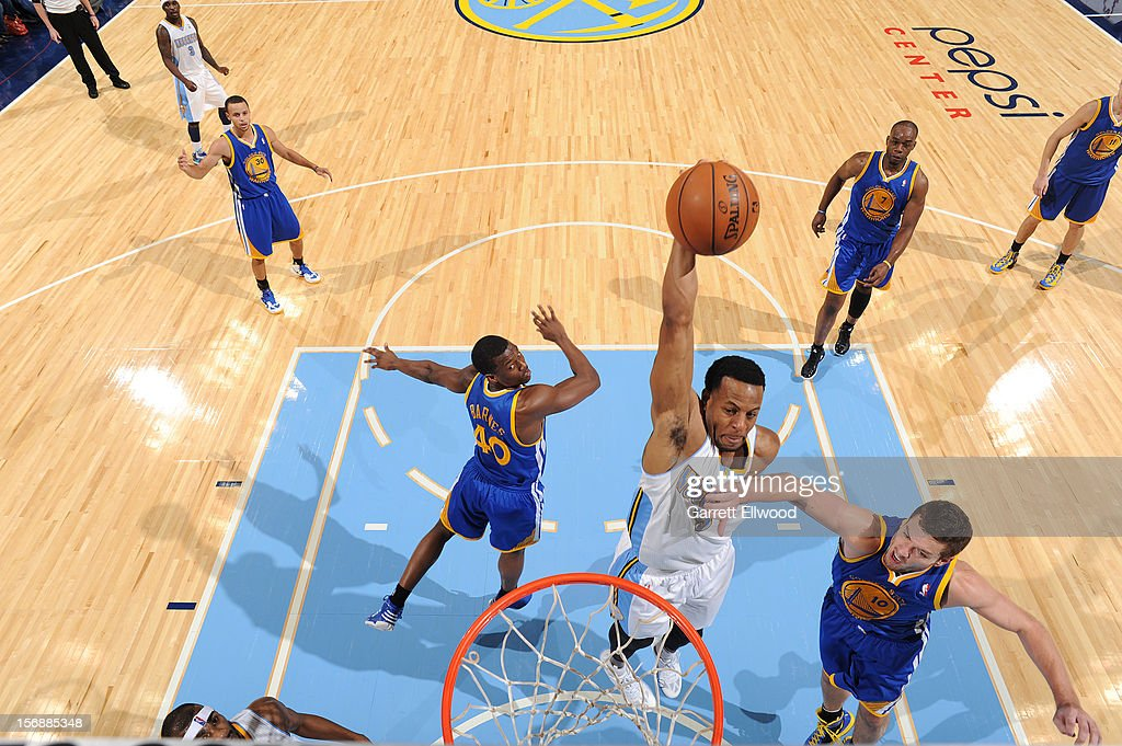 <a gi-track='captionPersonalityLinkClicked' href=/galleries/search?phrase=Andre+Iguodala&family=editorial&specificpeople=201980 ng-click='$event.stopPropagation()'>Andre Iguodala</a> #9 of the Denver Nuggets dunks the ball against David Lee #10 of the Golden State Warriors on November 23, 2012 at the Pepsi Center in Denver, Colorado.