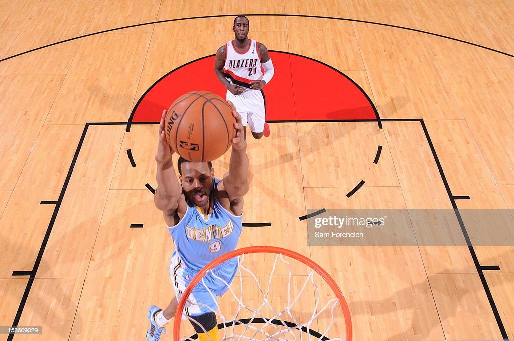 <a gi-track='captionPersonalityLinkClicked' href=/galleries/search?phrase=Andre+Iguodala&family=editorial&specificpeople=201980 ng-click='$event.stopPropagation()'>Andre Iguodala</a> #9 of the Denver Nuggets goes in for the two handed slamdunk against the Portland Trailblazers on December 20, 2012 at the Rose Garden Arena in Portland, Oregon.