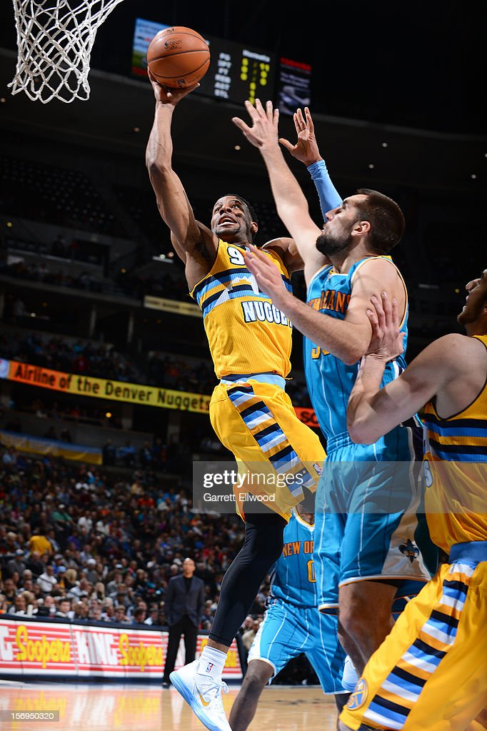 Andre Iguodala #9 of the Denver Nuggets goes to the basket against Ryan Anderson #33 of the New Orleans Hornets during the game between the New Orleans Hornets and the Denver Nuggets on November 25, 2012 at the Pepsi Center in Denver, Colorado.