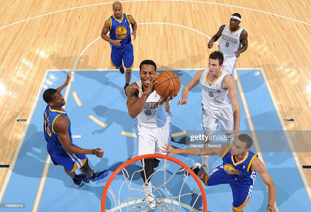 <a gi-track='captionPersonalityLinkClicked' href=/galleries/search?phrase=Andre+Iguodala&family=editorial&specificpeople=201980 ng-click='$event.stopPropagation()'>Andre Iguodala</a> #9 of the Denver Nuggets goes to the basket against the Golden State Warriors on November 23, 2012 at the Pepsi Center in Denver, Colorado.