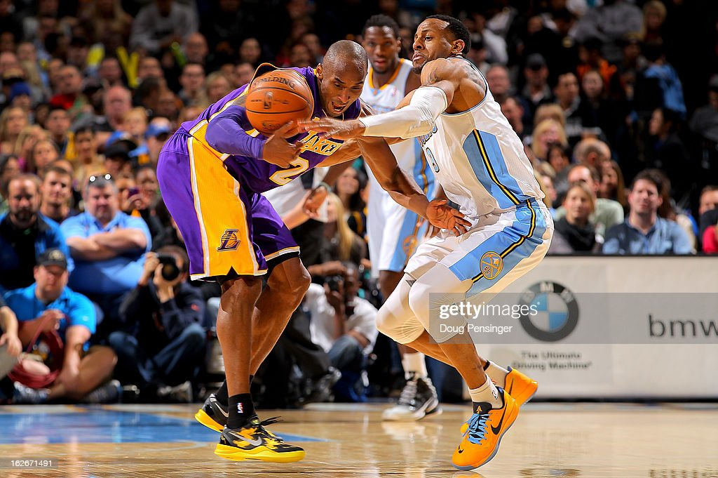 Andre Iguodala #9 of the Denver Nuggets knocks the ball away from Kobe Bryant #24 of the Los Angeles Lakers at the Pepsi Center on February 25, 2013 in Denver, Colorado.