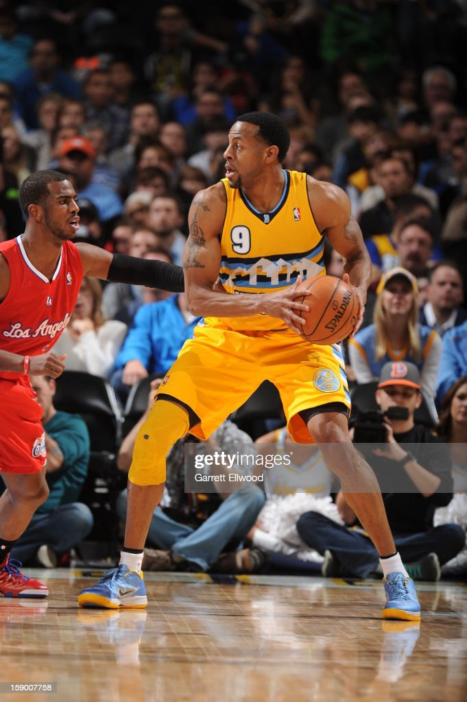 <a gi-track='captionPersonalityLinkClicked' href=/galleries/search?phrase=Andre+Iguodala&family=editorial&specificpeople=201980 ng-click='$event.stopPropagation()'>Andre Iguodala</a> #9 of the Denver Nuggets looks to pass the ball against the Los Angeles Clippers on January 1, 2013 at the Pepsi Center in Denver, Colorado.