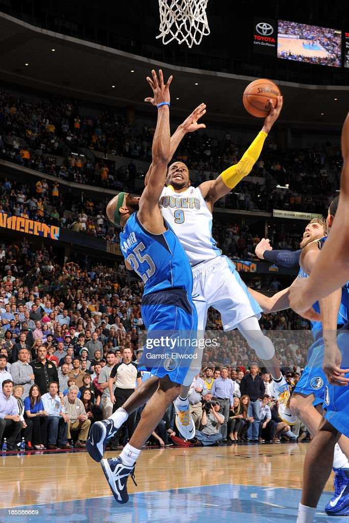 Andre Iguodala #9 of the Denver Nuggets makes a go-ahead layup late in the fourth quarter against Vince Carter #25 of the Dallas Mavericks, leading to his team's victory, on April 4, 2013 at the Pepsi Center in Denver, Colorado.