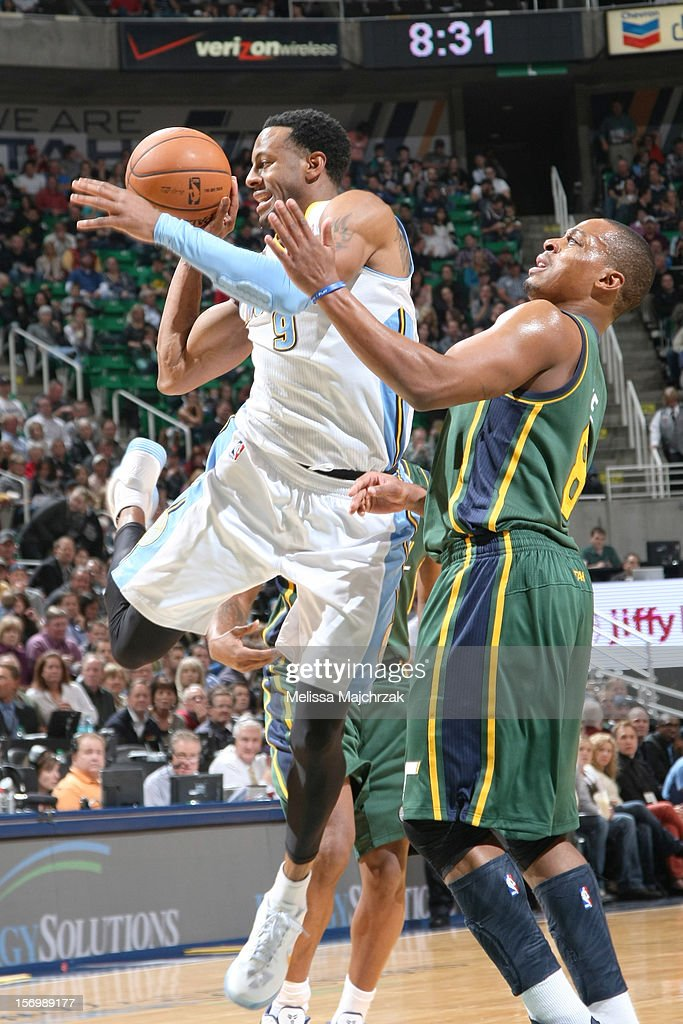 <a gi-track='captionPersonalityLinkClicked' href=/galleries/search?phrase=Andre+Iguodala&family=editorial&specificpeople=201980 ng-click='$event.stopPropagation()'>Andre Iguodala</a> #9 of the Denver Nuggets passes away from <a gi-track='captionPersonalityLinkClicked' href=/galleries/search?phrase=Randy+Foye&family=editorial&specificpeople=240185 ng-click='$event.stopPropagation()'>Randy Foye</a> #8 of the Utah Jazz at Energy Solutions Arena on November 26, 2012 in Salt Lake City, Utah.