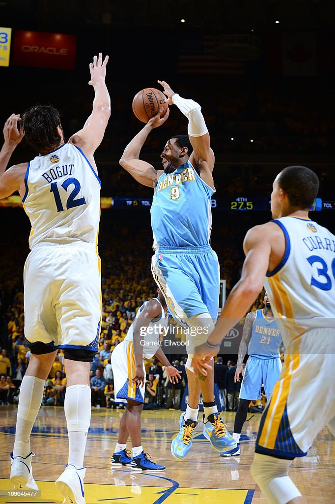 <a gi-track='captionPersonalityLinkClicked' href=/galleries/search?phrase=Andre+Iguodala&family=editorial&specificpeople=201980 ng-click='$event.stopPropagation()'>Andre Iguodala</a> #9 of the Denver Nuggets passes the ball against <a gi-track='captionPersonalityLinkClicked' href=/galleries/search?phrase=Andrew+Bogut&family=editorial&specificpeople=207105 ng-click='$event.stopPropagation()'>Andrew Bogut</a> #12 of the Golden State Warriors in Game Three of the Western Conference Quarterfinals during the 2013 NBA Playoffs on April 26, 2013 at the Oracle Arena in Oakland, California.