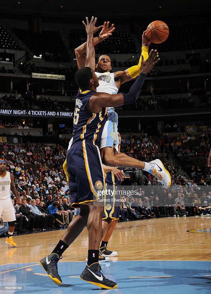 Andre Iguodala #9 of the Denver Nuggets passes the ball against Roy Hibbert #55 of the Indiana Pacers on January 28, 2013 at the Pepsi Center in Denver, Colorado.