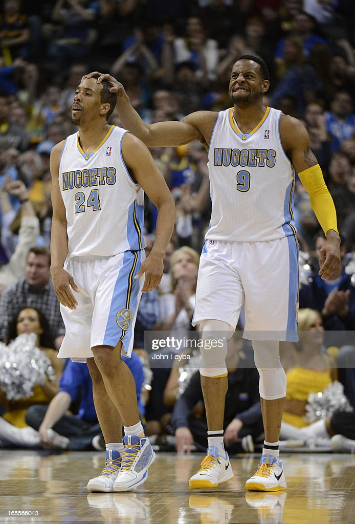 Andre Iguodala (9) of the Denver Nuggets puts his hand on Andre Miller (24) of the Denver Nuggets head after scoring and getting fouled int he fourth quarter April 4, 2013 at Pepsi Center. The Denver Nuggets defeated the Dallas Mavericks 95-94.