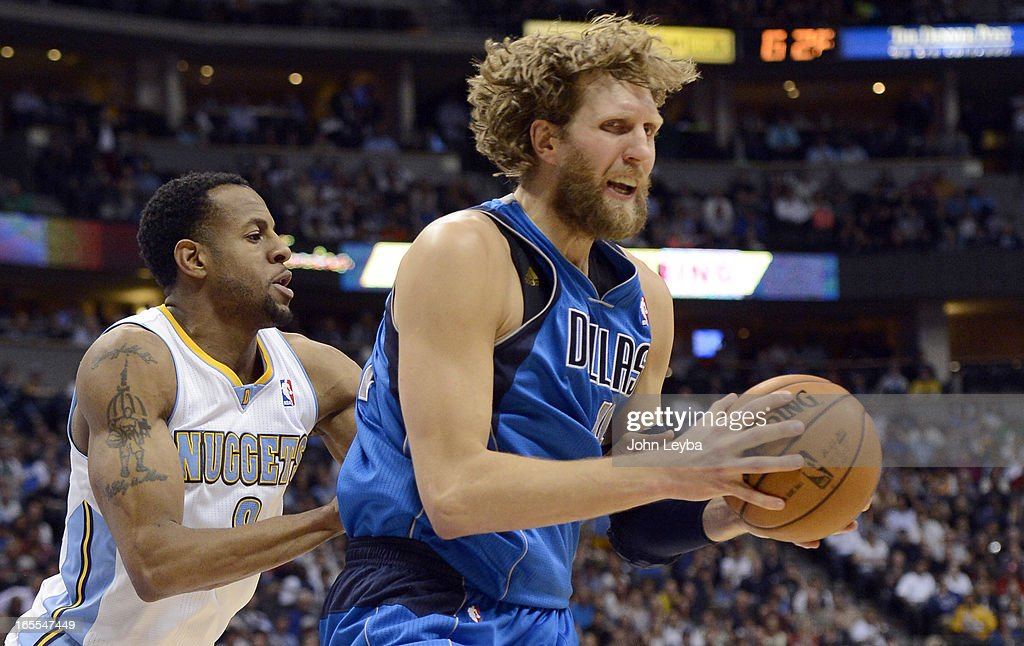 Andre Iguodala (9) of the Denver Nuggets puts pressure on Dirk Nowitzki (41) of the Dallas Mavericks during the fourth quarter April 4, 2013 at Pepsi Center.