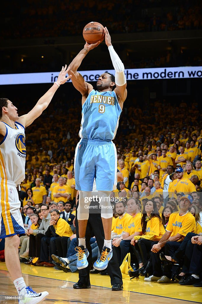 <a gi-track='captionPersonalityLinkClicked' href=/galleries/search?phrase=Andre+Iguodala&family=editorial&specificpeople=201980 ng-click='$event.stopPropagation()'>Andre Iguodala</a> #9 of the Denver Nuggets shoots a three pointer against <a gi-track='captionPersonalityLinkClicked' href=/galleries/search?phrase=Klay+Thompson&family=editorial&specificpeople=5132325 ng-click='$event.stopPropagation()'>Klay Thompson</a> #11 of the Golden State Warriors in Game Three of the Western Conference Quarterfinals during the 2013 NBA Playoffs on April 26, 2013 at the Oracle Arena in Oakland, California.