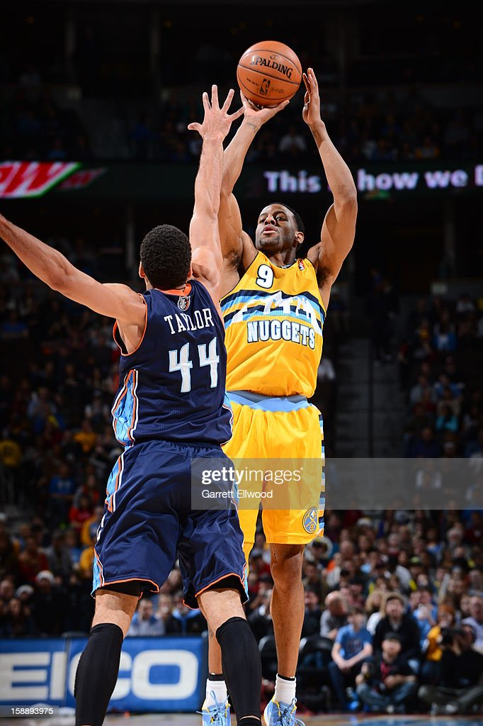 <a gi-track='captionPersonalityLinkClicked' href=/galleries/search?phrase=Andre+Iguodala&family=editorial&specificpeople=201980 ng-click='$event.stopPropagation()'>Andre Iguodala</a> #9 of the Denver Nuggets shoots against Jeffery Taylor #44 of the Charlotte Bobcats on December 22, 2012 at the Pepsi Center in Denver, Colorado.