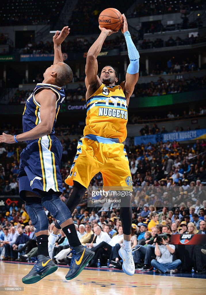 <a gi-track='captionPersonalityLinkClicked' href=/galleries/search?phrase=Andre+Iguodala&family=editorial&specificpeople=201980 ng-click='$event.stopPropagation()'>Andre Iguodala</a> #9 of the Denver Nuggets shoots against the Utah Jazz on November 9, 2012 at the Pepsi Center in Denver, Colorado.