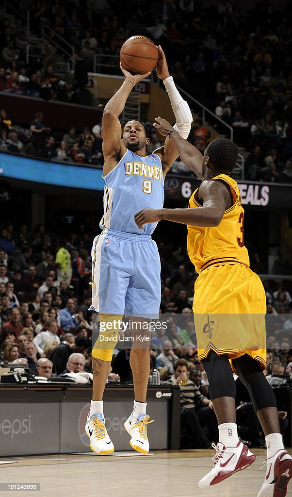 Andre Iguodala #9 of the Denver Nuggets shoots over Dion Waiters #3 of the Cleveland Cavaliers at The Quicken Loans Arena on February 9, 2013 in Cleveland, Ohio.